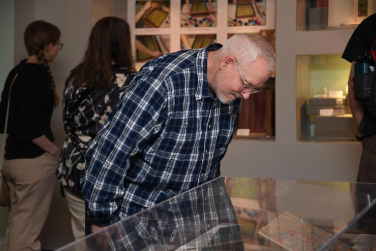 Papermaking Museum: Robert Thompson views items on display at the exhibit 'Marvelous Marbling: Demystifying Marbled Papers'