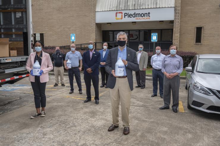 Dr. Abdallah congratulates hand sanitizer initiative