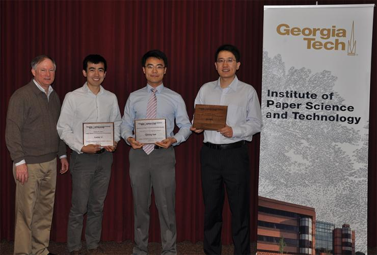 Left to right: Lester Li, Qining Sun and Jie Wu receive awards from IPST communications manager Steve Forsyth at the Georgia Tech Research and Innovation Conference.